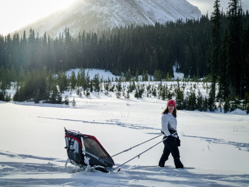 snowshoeing with a baby  in a chariot with ski attachment