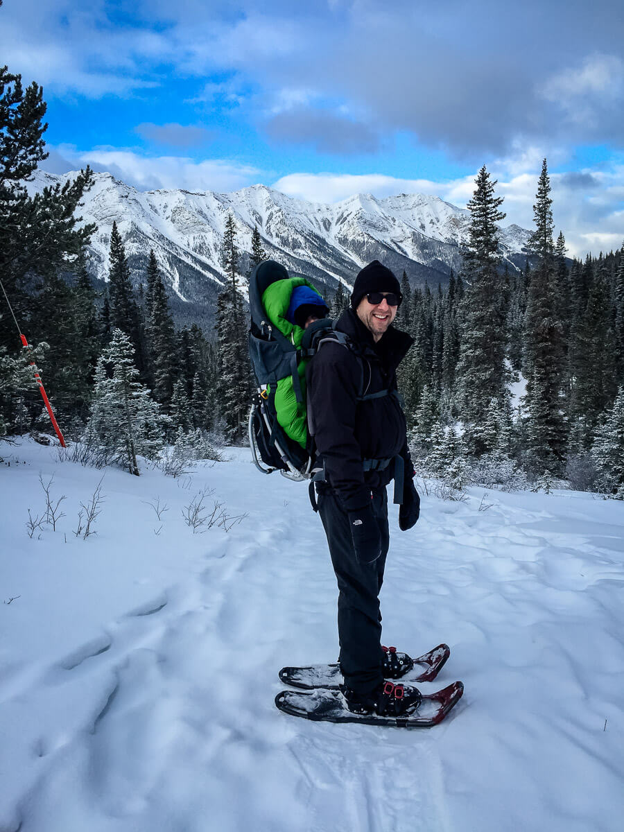 snowshoe with baby in hiking backpack carrier