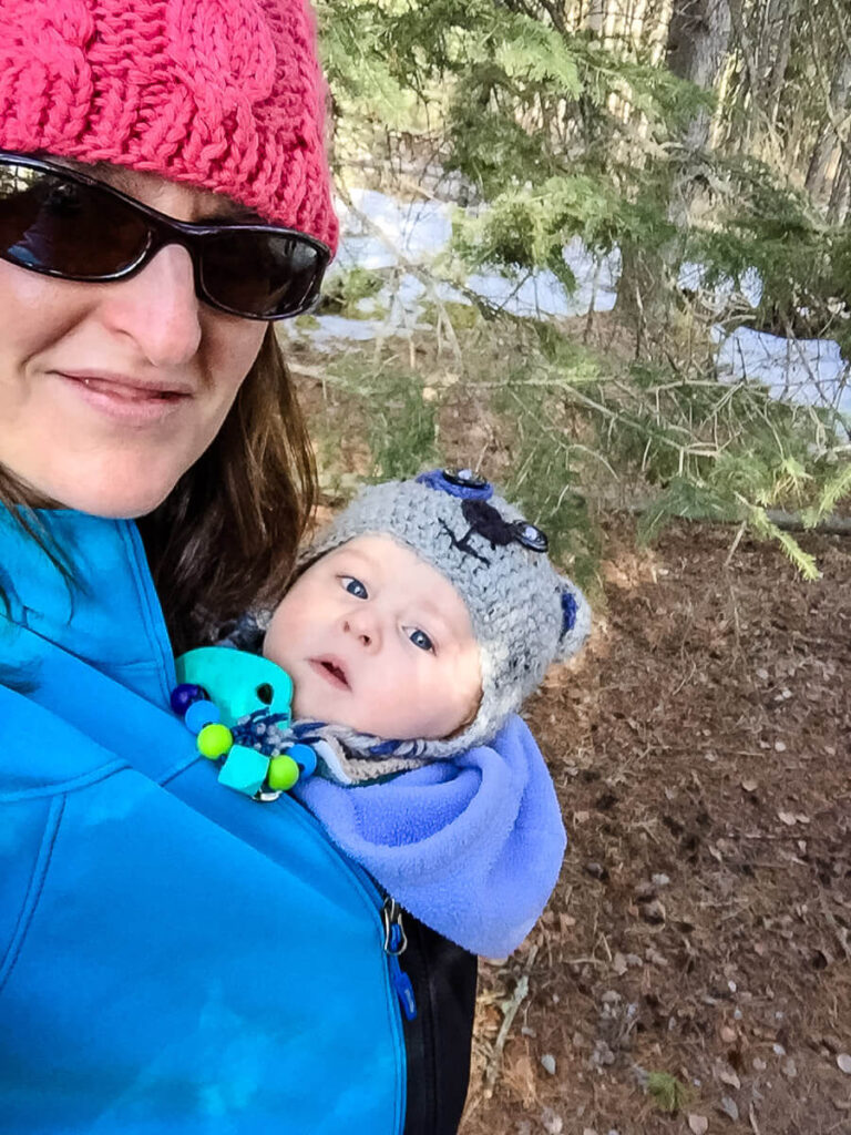 taking baby for a walk in cold weather in baby carrier and using jacket extender