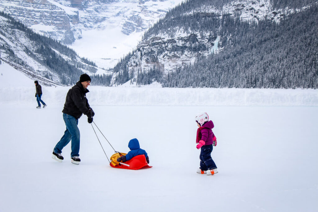 skating on Lake Louise in winter with baby and toddler