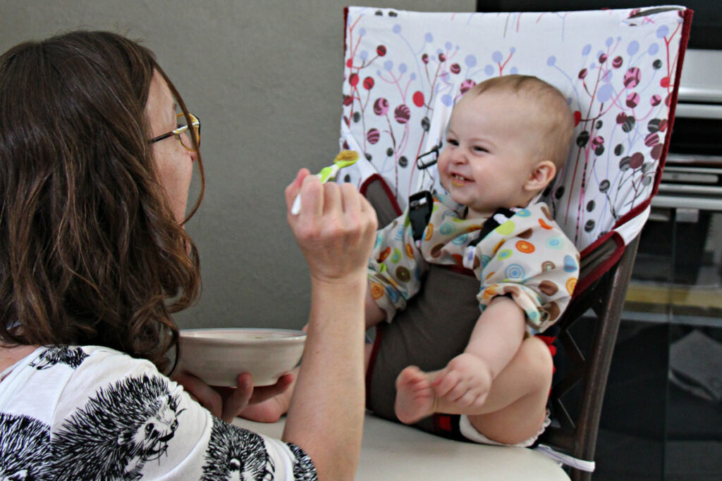 baby in my little seat travel high chair being fed