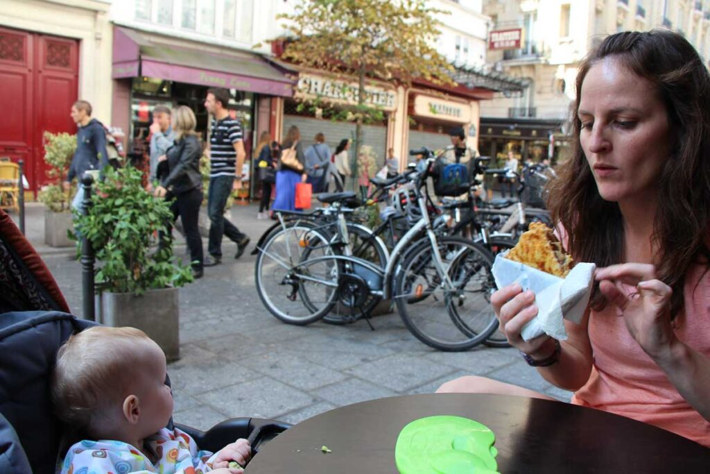 mother and baby eating outside in paris