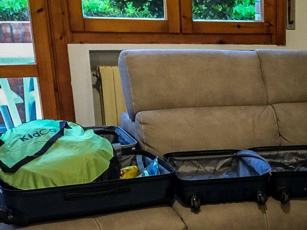 Folding KidCo PeaPod Plus has it fitting in a suitcase