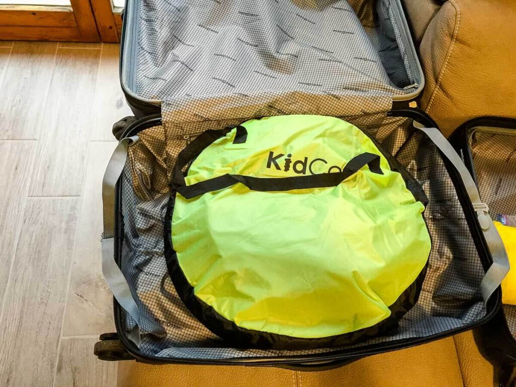 kidco peapod plus travel bed for toddlers folded in suitcase
