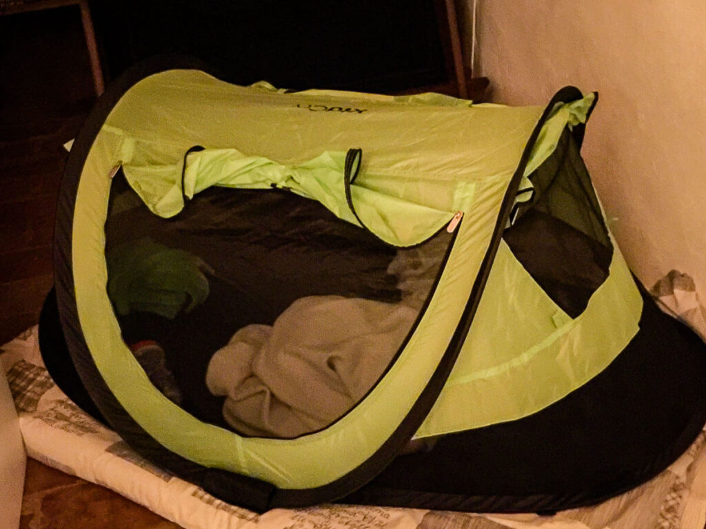 Toddler in peapod sleeping tent