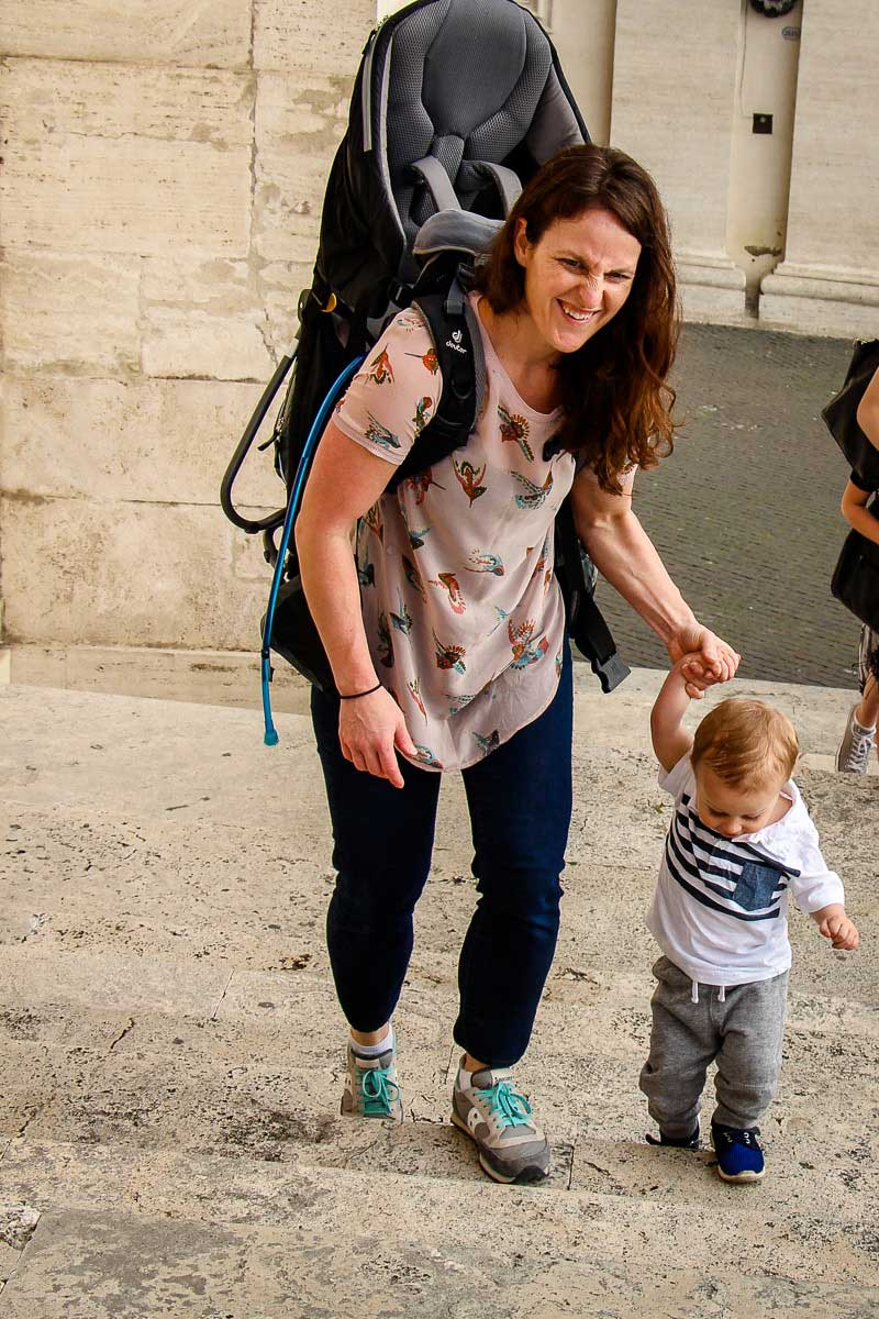 walking with toddler in Rome using hiking backpack carrier