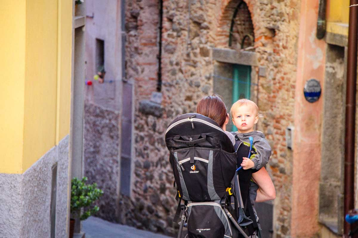 Carrying baby and using a hiking backpack carrier for toddlers in Cinque Terre Italy