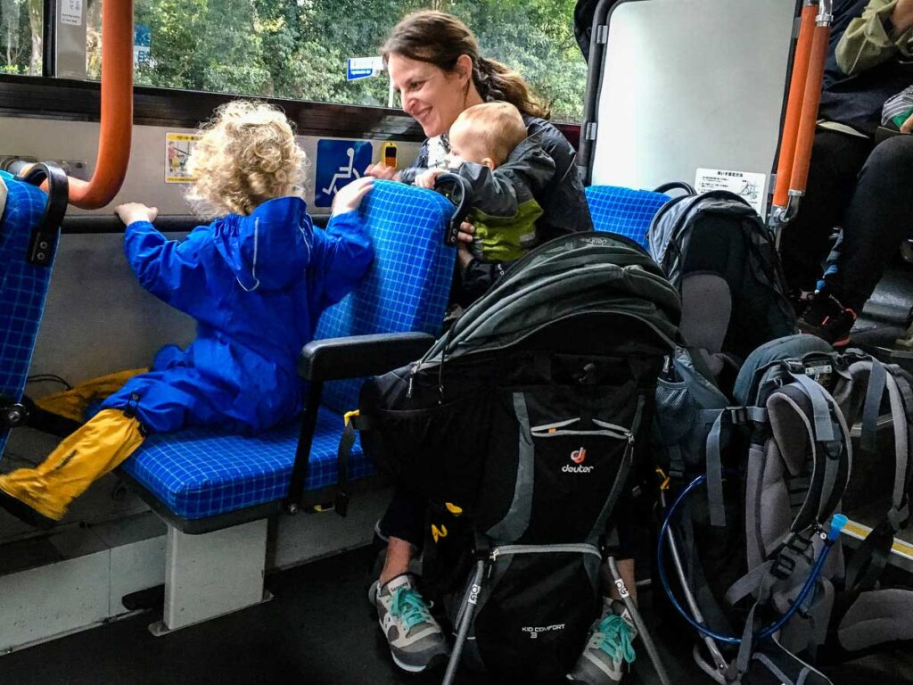 travel with baby backpack carrier on bus in Kyoto