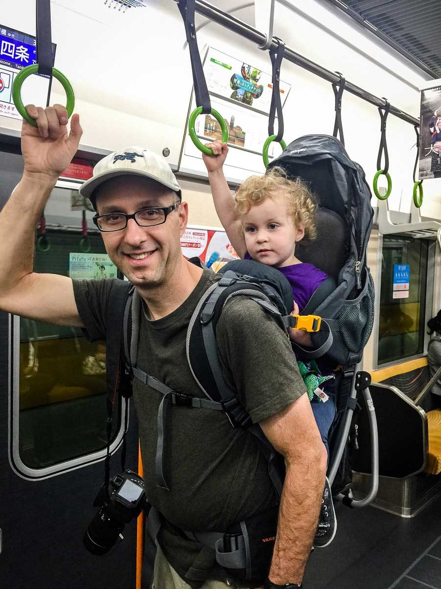taking public transit with hiking backpack carrier for toddlers