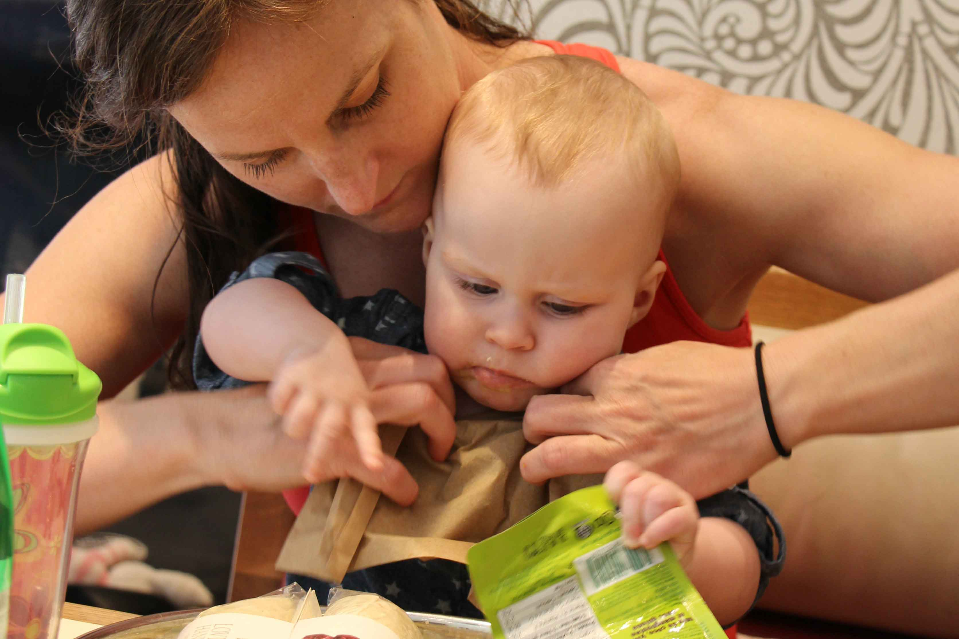 Baby-Can-Travel---Travel-Highchair-Comparison---Baby-Eating-on-lap