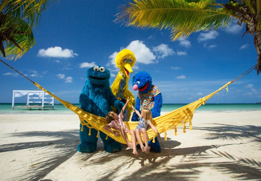 Cookie Monster, Big Bird and Grover visit with guests at Beaches Negril