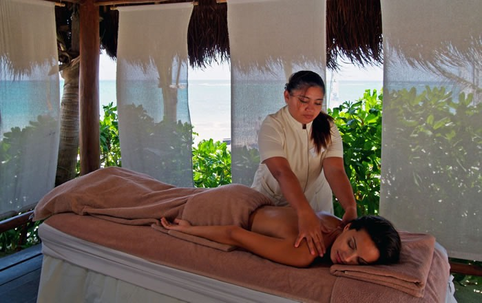 Lady enjoying a massage at Grand Palladium