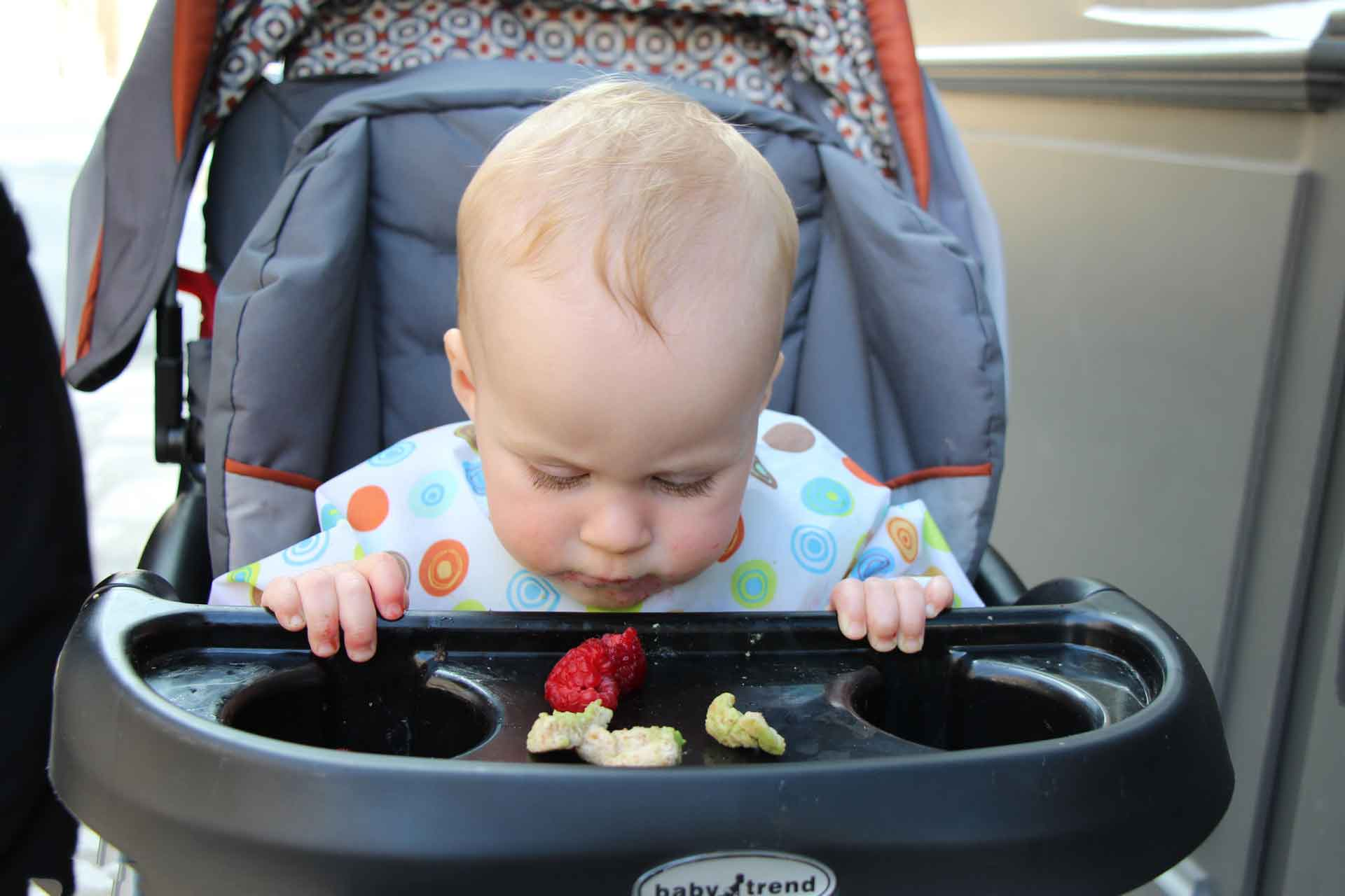 Stroller with a tray for travel with a baby