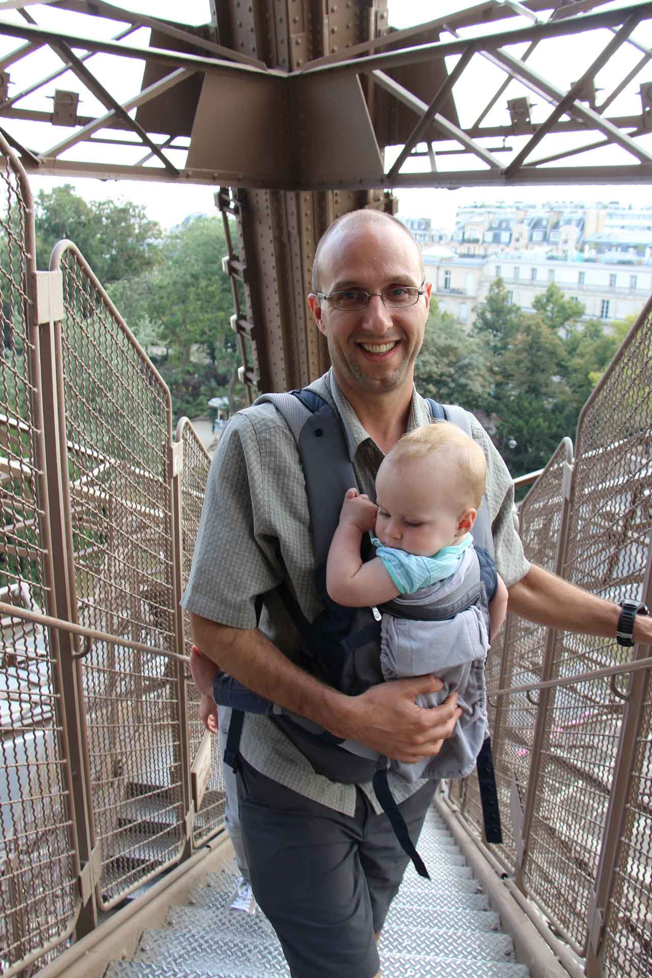 Climbing stairs at Eiffel Tower in Paris with a baby