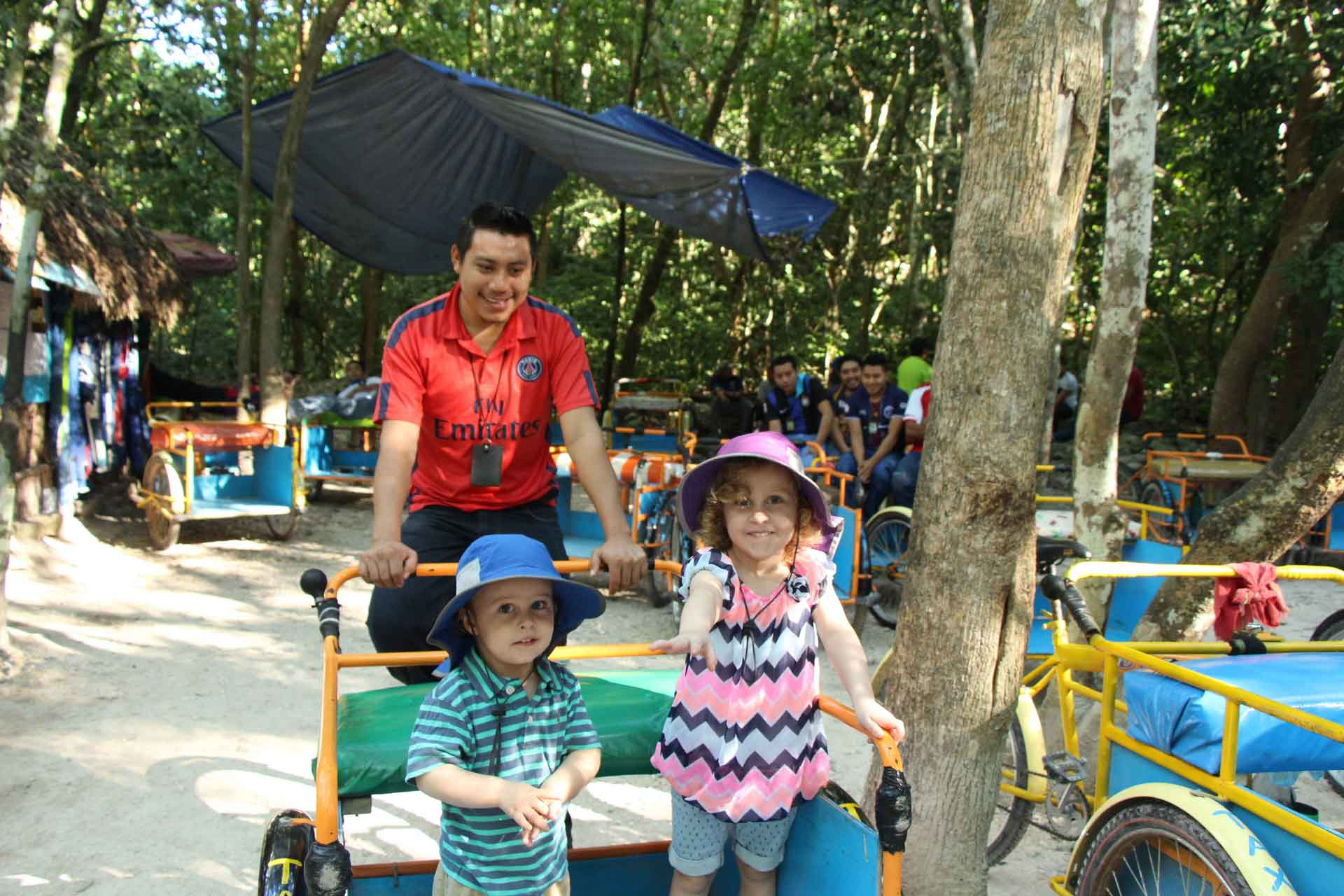 Riding bike in Coba with children