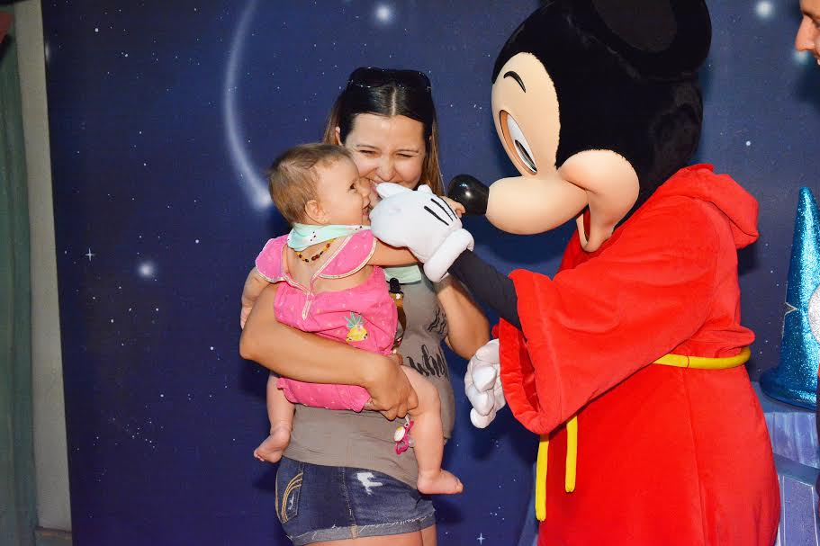 Character greetings at Disneyland with a baby