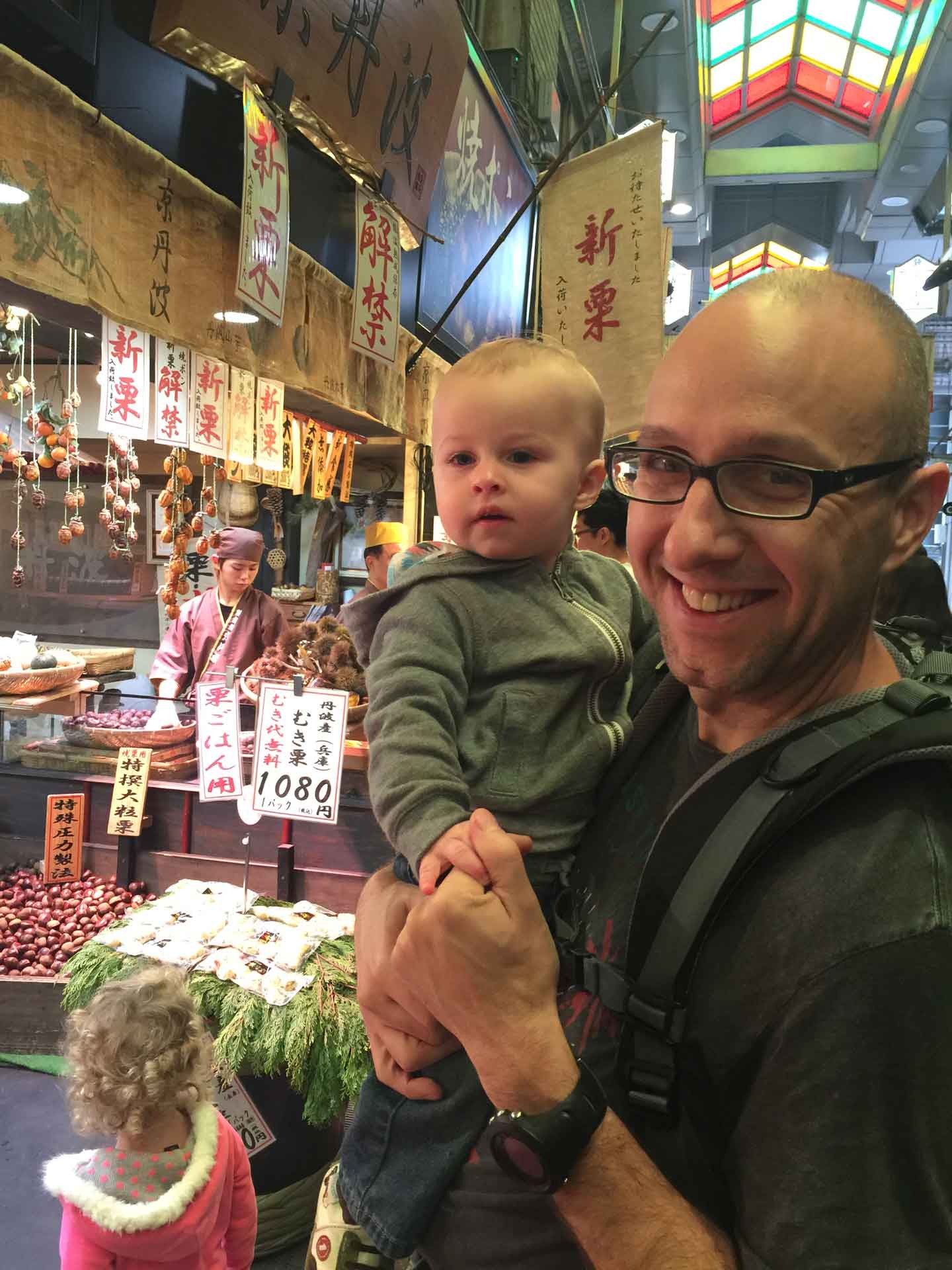 Nishiki Market in Kyoto Japan with a baby