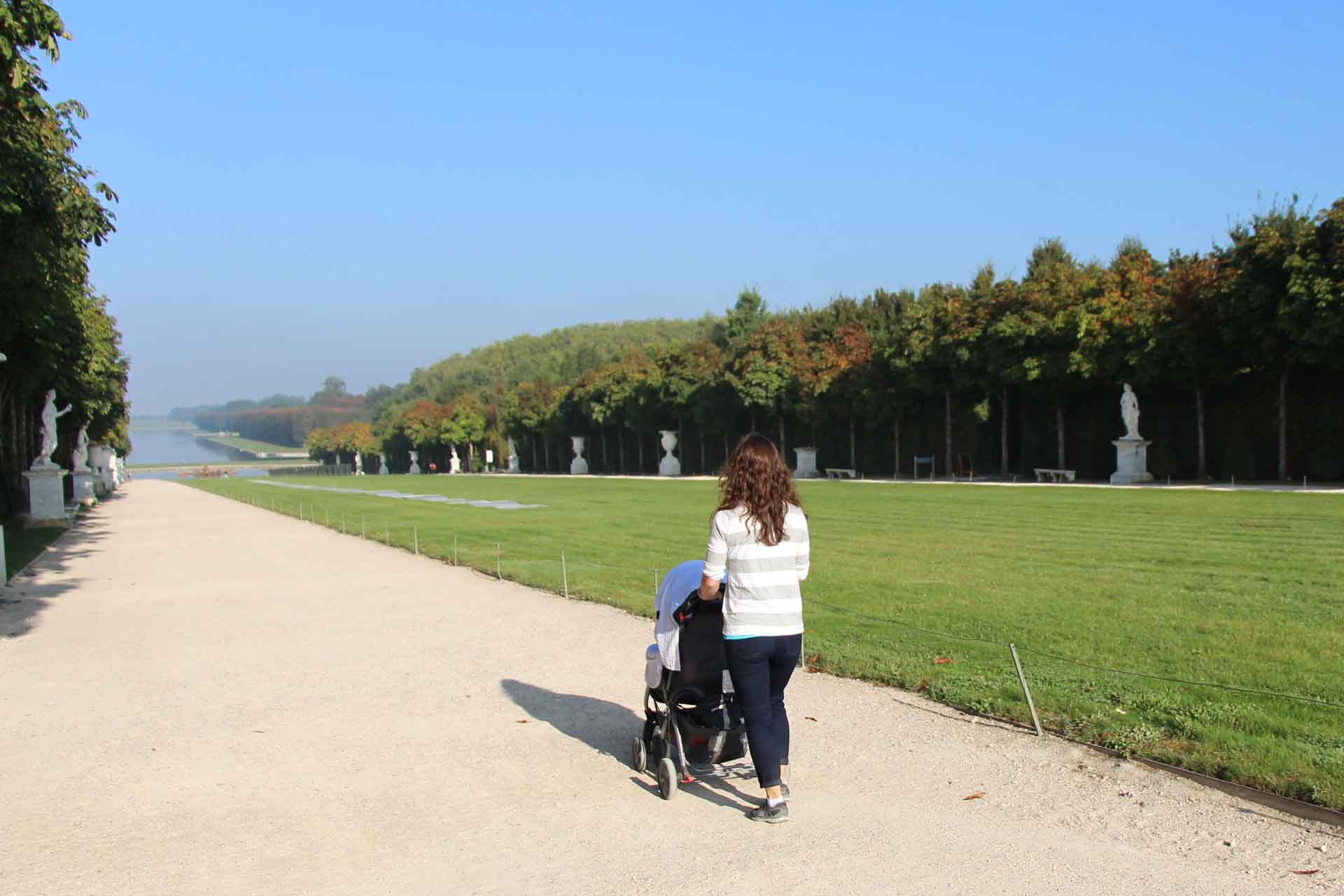 Walking with baby in stroller at the Palace de Versailles