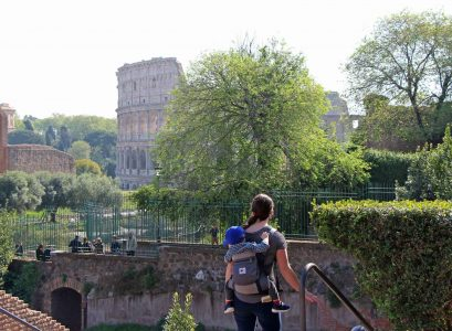 View of Colosseum in Rome Italy with toddler