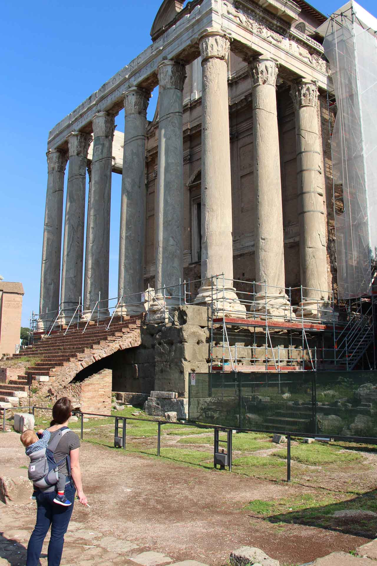 Roman forum in Rome Italy with toddler in carrier