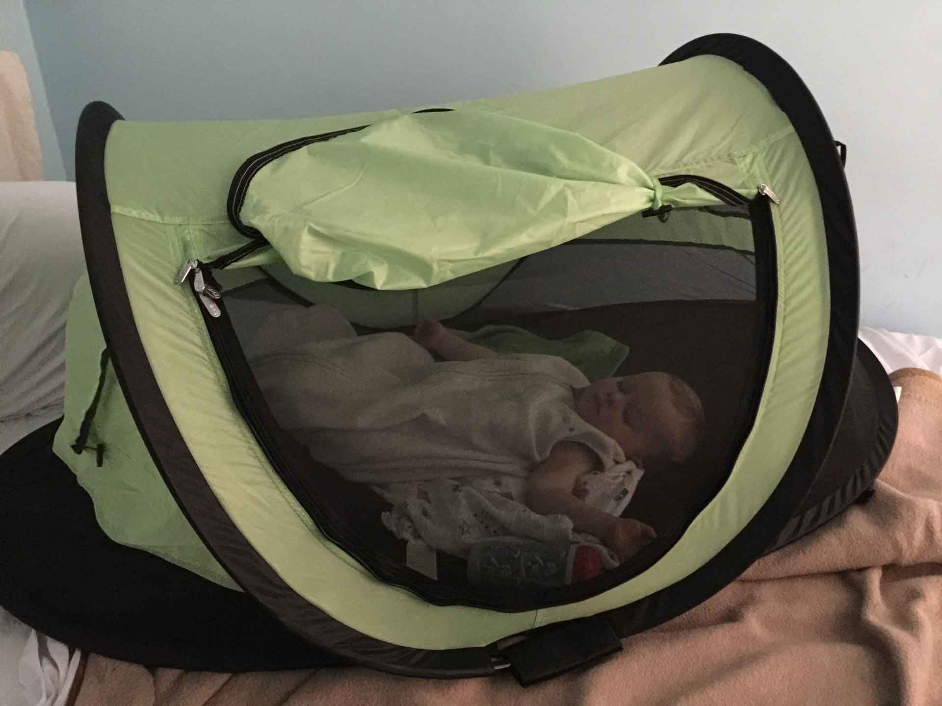 Toddler Sleeping in KidCo PeaPod Plus Travel Tent