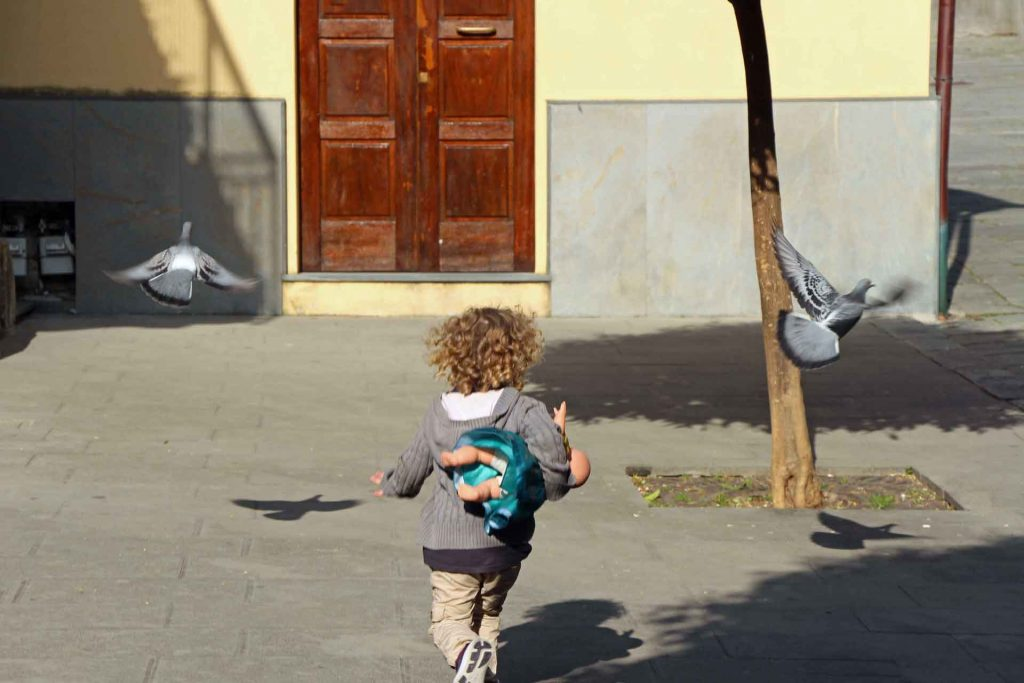 Visiting Italy with kids ultimately means watching them chase pigeons all day longh toddler