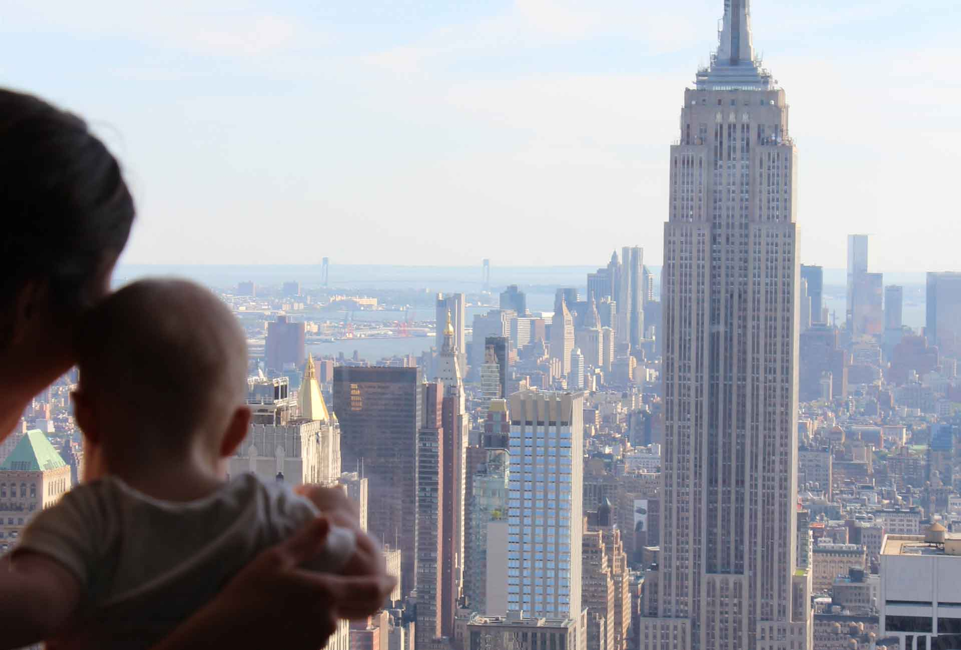 View of Empire State Building NYC with a baby