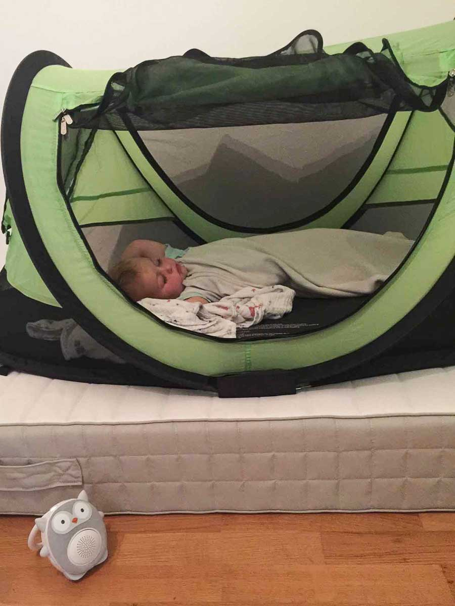 using white noise machine and toddler travel tent - travelling essentials for baby