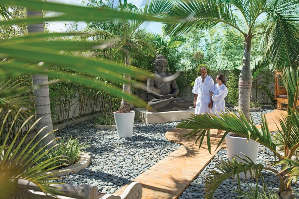 A couple walking through the spa gardens