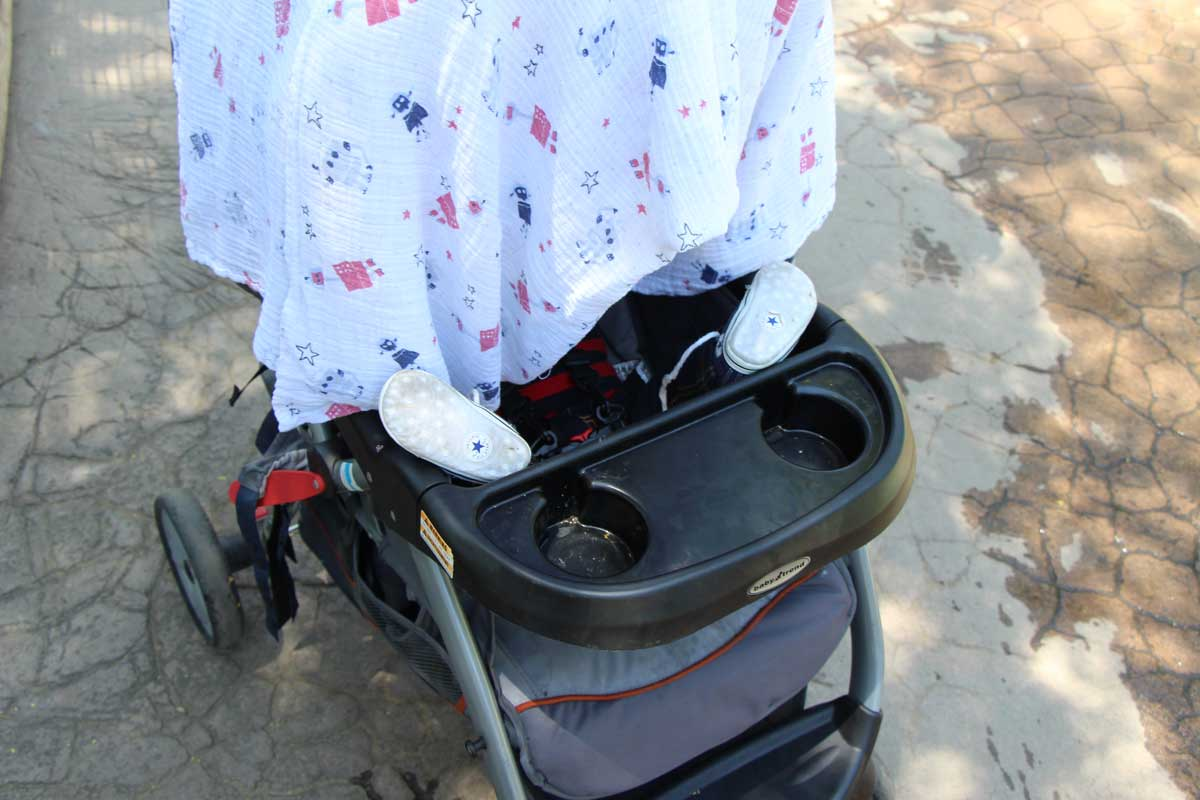 baby stroller and blanket - travelling essentials for baby