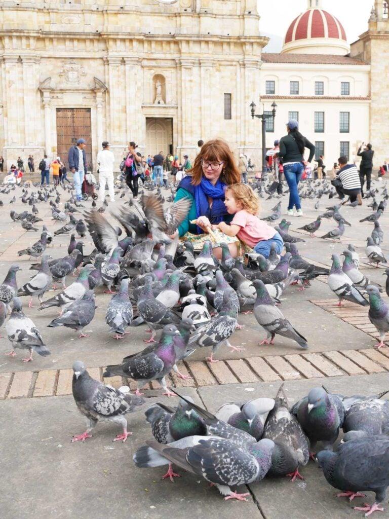 Feeding pigeons Plaza Bolivar Bogota with Toddler