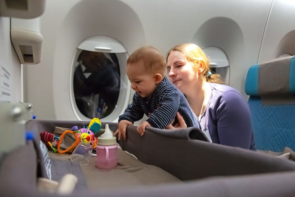 mother entertaining baby on flight