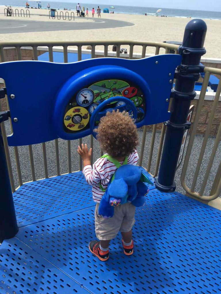 Image of toddler at playground in Huntington Beach