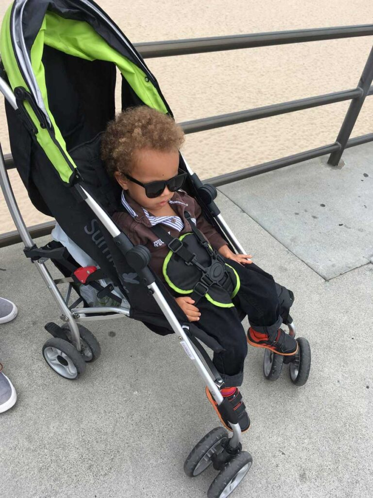 image of toddler in lightweight travel stroller