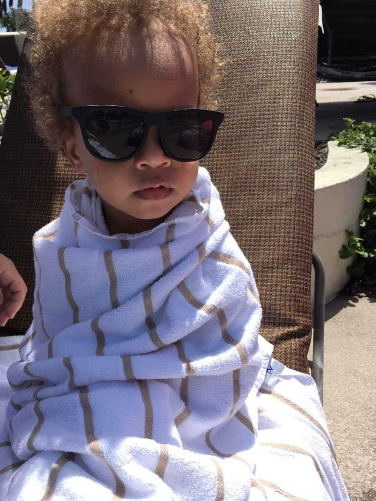 image of toddler wrapped in towel at hotel in Huntington Beach