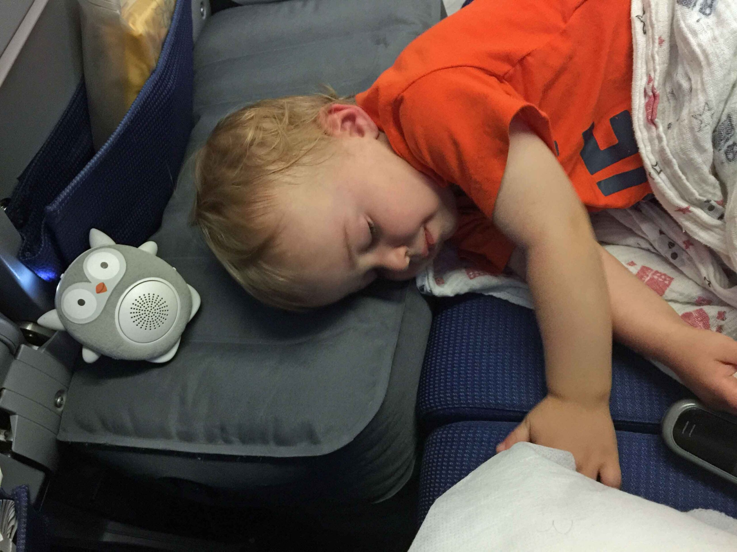 toddler sleeping on airplane