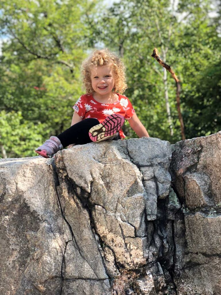 image of toddler on rocks along Kancamagus scenic drive