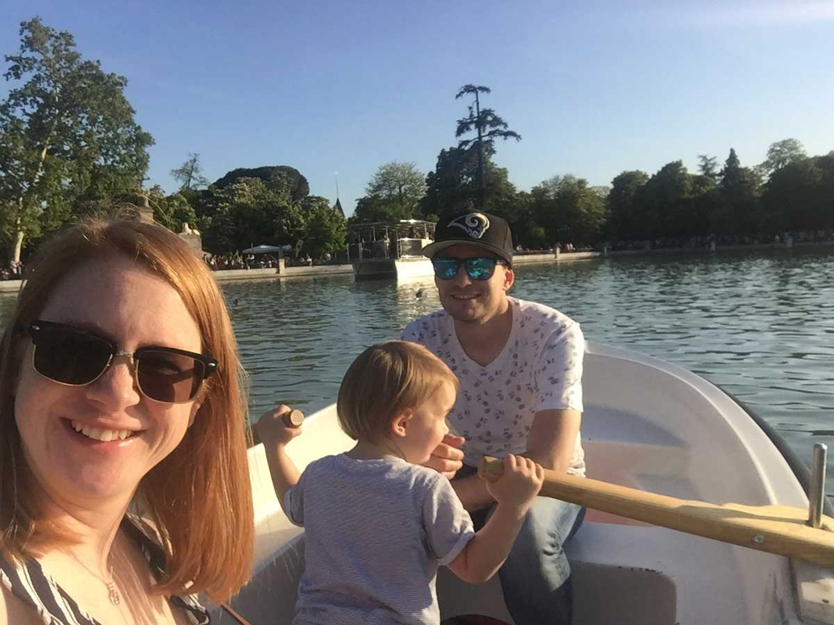 image of family on boat on Lake Retiro in Madrid Spain
