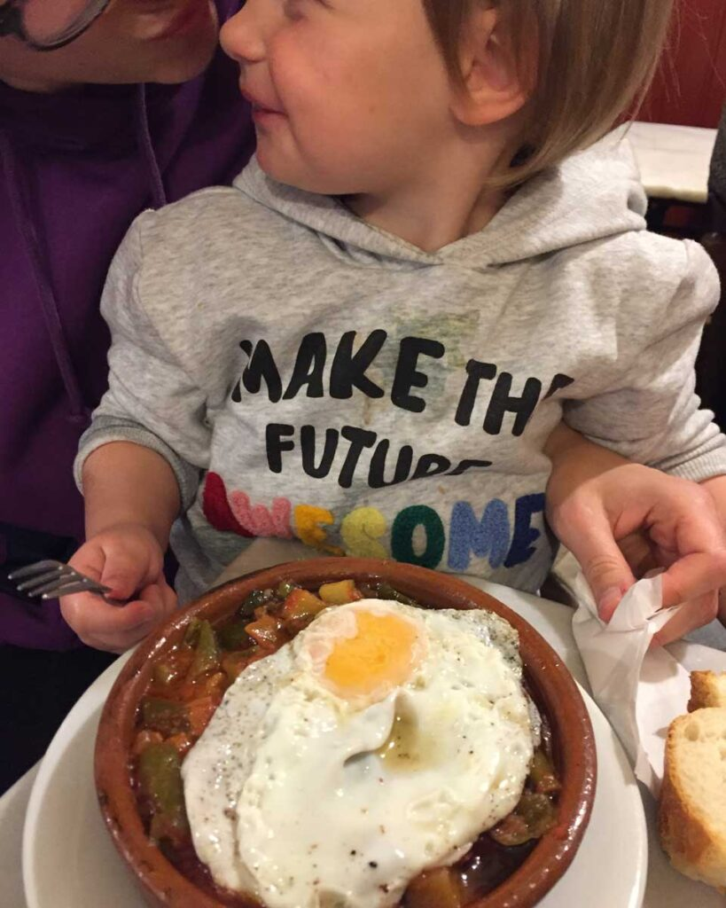 toddler eating in Madrid Spain