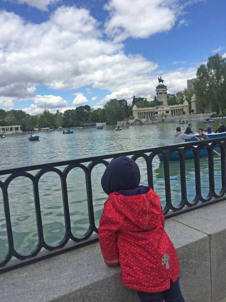 toddler overlooking lake in Madrid