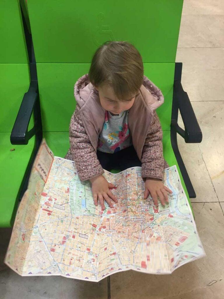 toddler looking at map