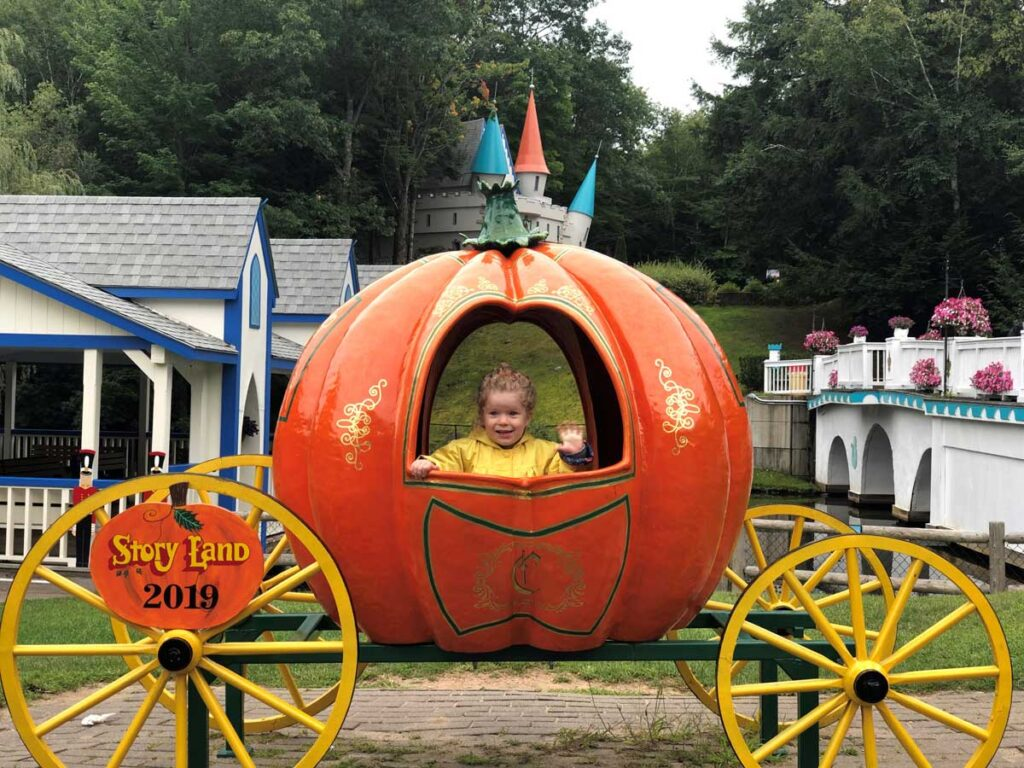 image of toddler in pumpkin coach at Story Land