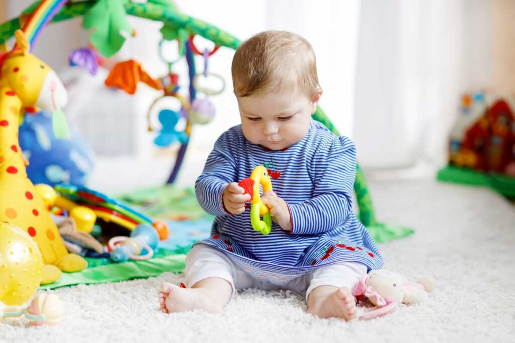 image of baby playing with toys