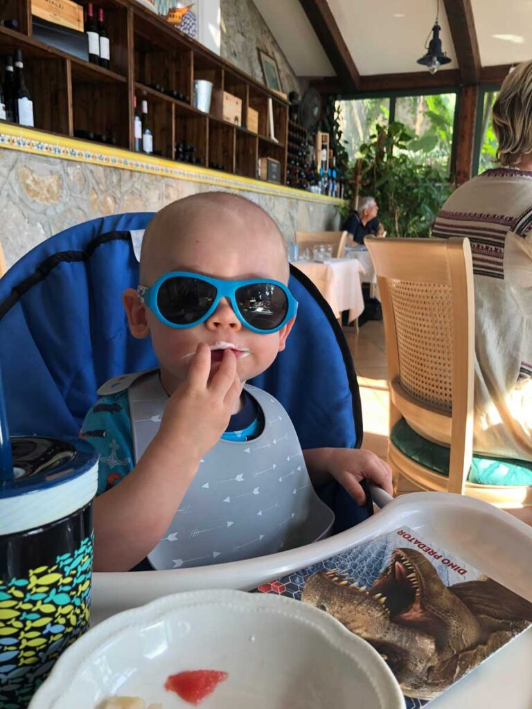 image of baby eating in high chair in Italy