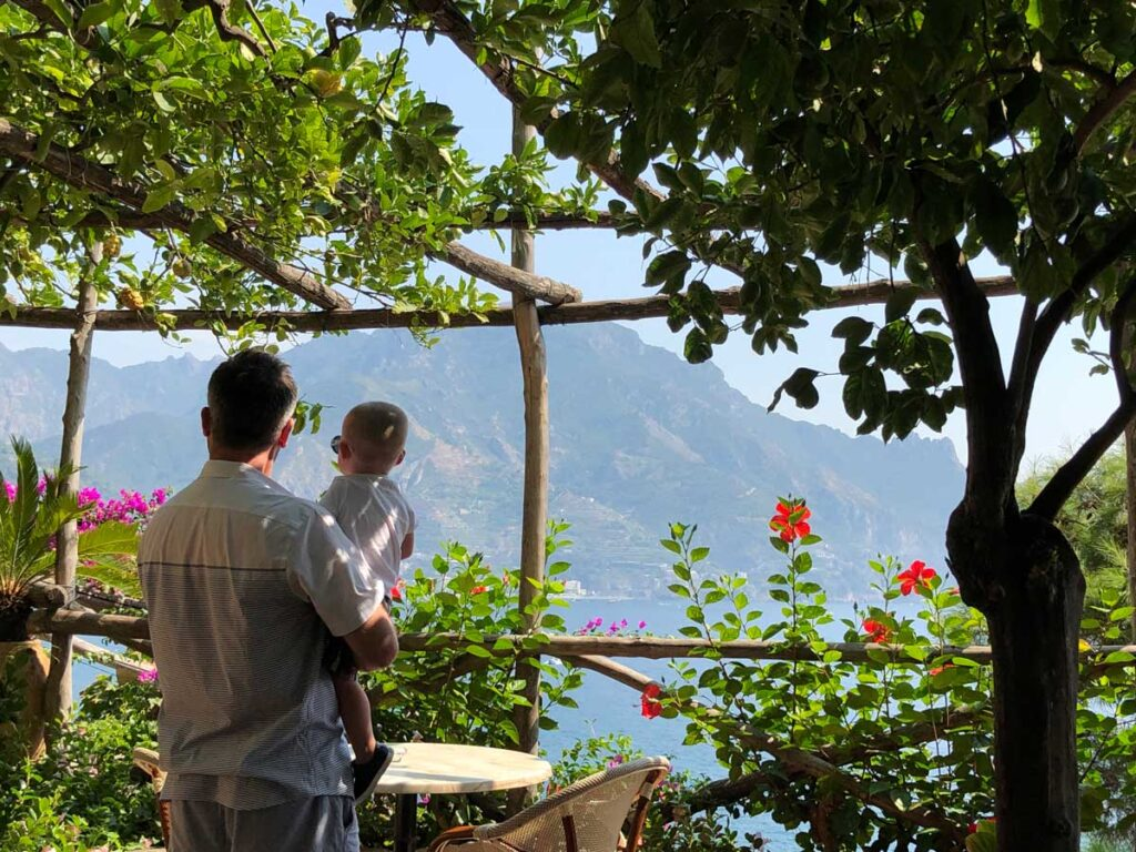 image of man and baby looking at the view from hotel in Castiglione