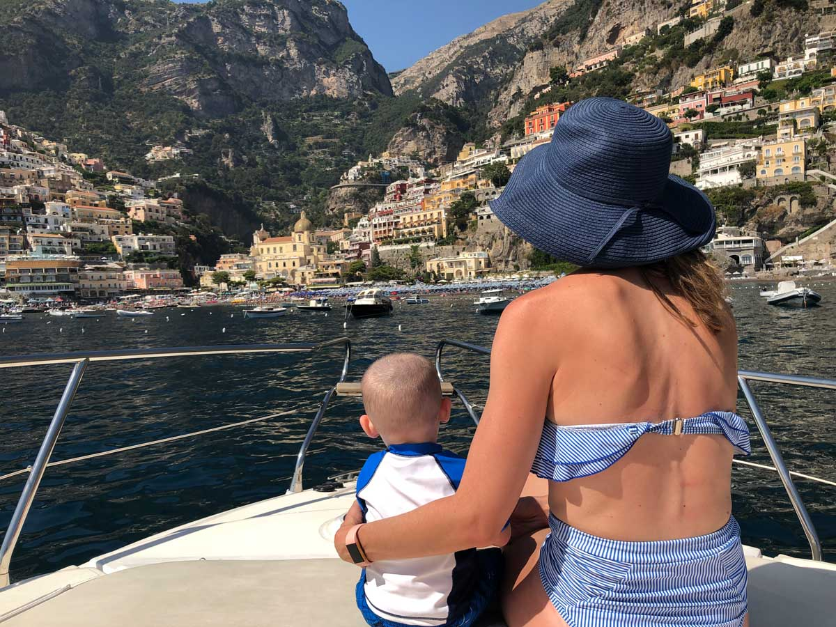 image of mother and baby on boat along Amalfi Coast
