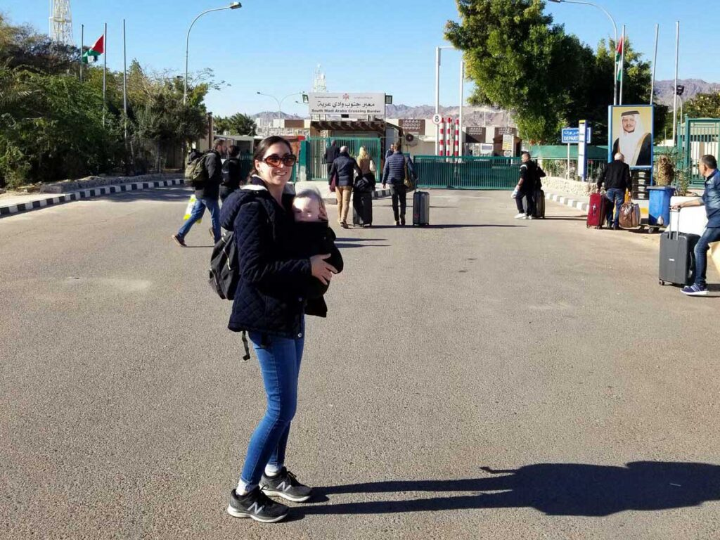 image of mother with baby in baby carrier for border crossing Israel Jordan