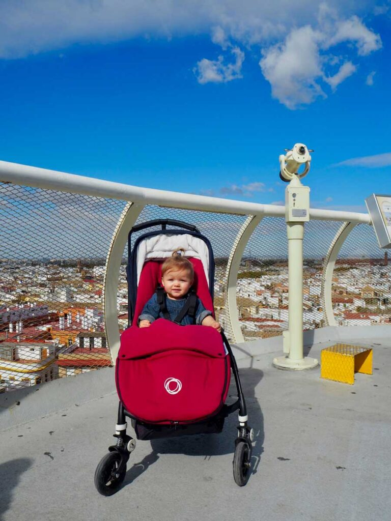 image of baby in stroller in Seville - Metropol Parasol