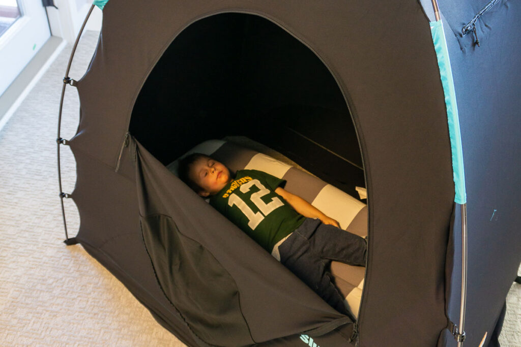 image of boy on inflatable toddler bed in Slumberpod