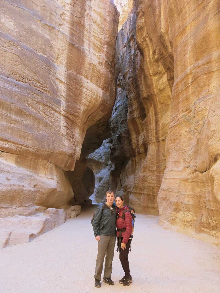 image of family standing at entrance to the Siq at Petra Jordan
